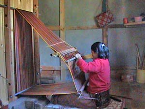 Weaver at her loom